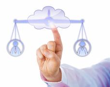 Balancing A Male And A Female Worker In The Cloud Stock Photos