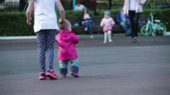 a little girl raised her sister when she fell - stock footage