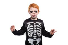 Adorable red hair boy disguised in halloween Stock Photos