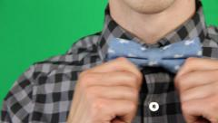 Close up Pan of Male Straightening Bow Tie Stock Footage