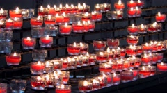 4K footage of burning candles in the Salzburg Cathedral in Salzburg, Austria Stock Footage
