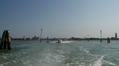 Water taxi speeding by in Venice Italy Stock Footage