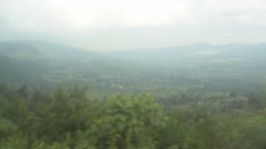 Driving through great rift valley, Kenya, long shot Stock Footage