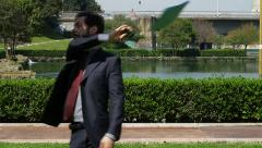 Angry businessman throws his documents and goes away after a phone call Stock Footage