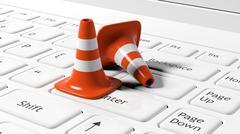 Orange traffic cones on white laptop keyboard - stock illustration