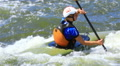 Young girl on  kayak. Rafting team  50% speed Footage