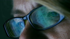 CU of computer reflected in woman's glasses, 4k, UHD Stock Footage