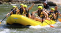 Yellow boat on  rough river with people . Rafting team  50% speed HD Footage