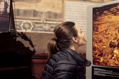 Young tourist admire fresco reconstruction in Italy church  NTSC Stock Footage