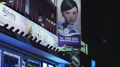 Attractive Asian model billboard zoom out HK 4K Stock Footage