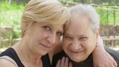 Old woman and daughter portrait Stock Footage