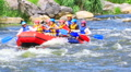 Boat with tourists on rough river close up. Rafting team   HD Footage