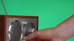 Hand switch on the radio and tune it chroma key dolly shot Stock Footage