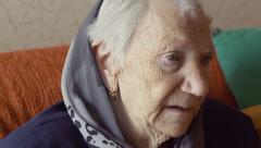 Depressed old woman on the sofa Stock Footage