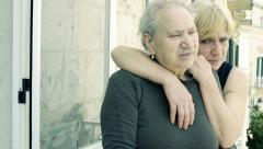 Sad old women hugging Stock Footage