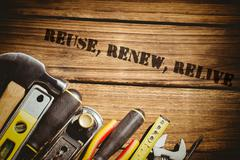 Reuse, renew, relive against tools on desk - stock photo