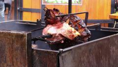 Spit with meat that is cooking on the coals and the fire: rotisserie Stock Footage