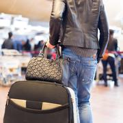 Female traveller walking airport terminal. - stock photo
