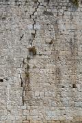 Texture of old, cracked rock wall. Stock Photos