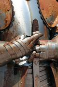 rusty armor and medieval sword of a soldier of Kings - stock photo