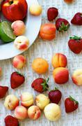 Summer Fruits Apricots, Strawberries, Peaches, Nectarines and Lime closeup on Wh Stock Photos