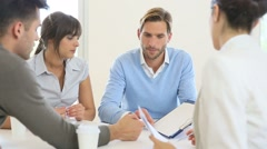 Business people meeting around table in modern space Stock Footage