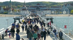 People strolling on the pier in Sopot, Poland Stock Footage