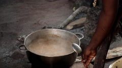 Woman cooking mankara Africa Stock Footage