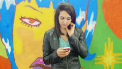 Sad and pensive young woman texting a short message on the mobile phone Stock Footage