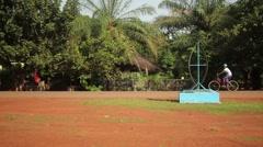 Girl ridding bike Africa Guine Bissau Stock Footage