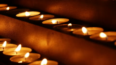 Votive candles in church, zoom in Stock Footage