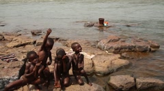 Kids in Africa river posing to camera Stock Footage