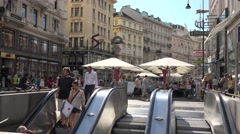 ULTRA HD 4K Crowded commercial road Vienna downtown famous brand escalator shop  Stock Footage