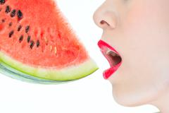 Fashion woman enjoy eating watermelon red lips, yummy, desire, Thirst - stock photo