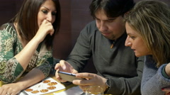 People at the restaurant using a tablet computer or XXL smartphone  Stock Footage