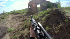 Person shoot from airsoft automatic rifle Stock Footage