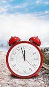 Composite image of alarm clock counting down to twelve Stock Illustration
