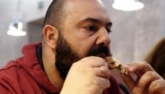 fat man eating chicken at the restaurant - stock footage