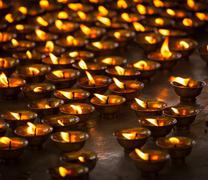 Burning candles in Buddhist temple, McLeod Ganj Stock Photos