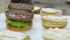 Food preparation: Cook realizes sandwiches with burger Stock Footage