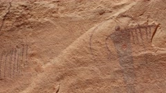 Native American Petroglyphs on a rock wall Stock Footage