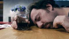 Drunk man sleep with the head over the bar Stock Footage