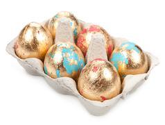 Gold easter egg isolated on white background - stock photo