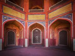 Arch with carved marble window. Mughal style - stock photo