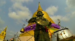 BANGKOK - March 2015: Bangkok's temple sculpture with clouds running through sky Stock Footage