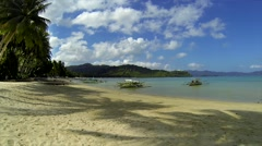Pristine Philippines beach view with pump boats. Stock Footage
