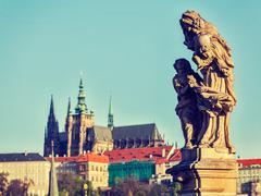 Statue on Charles Brigde in Prague Stock Photos