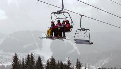 Group of skiers climb in the mountains. Frosty day ski resort. Stock Footage