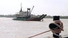 Ship floating on river in India. Stock Footage