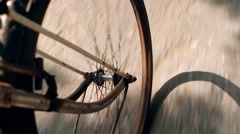 Rusty wheel riding  bicycle on road. Stock Footage
